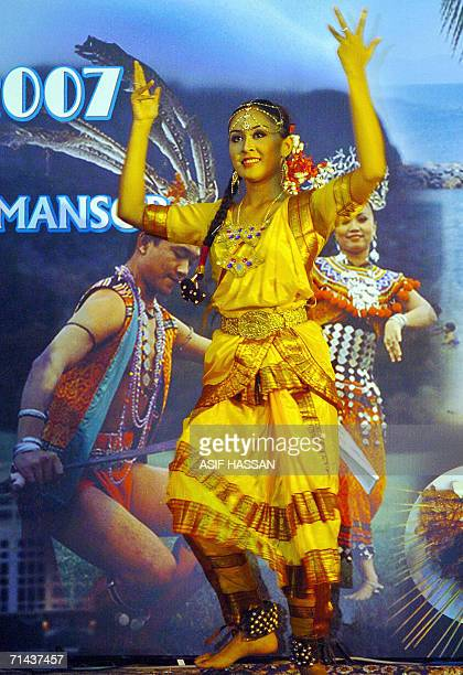 Members of a Malaysian troupe perform a traditional dance during a cultural show in Karachi late 13 July 2006 The show was organized to promote the...
