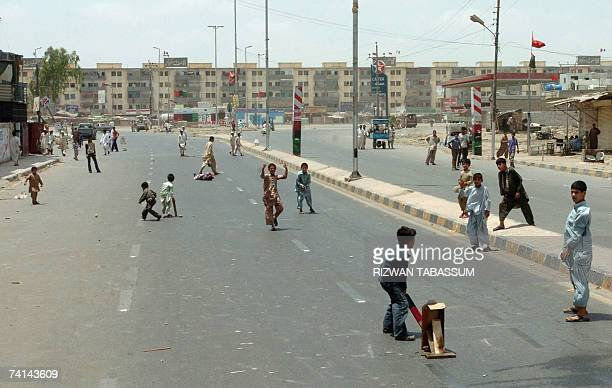 Pakistani Children Play Cricket On A Deserted Street During A Strike Called By Opposition Parties In