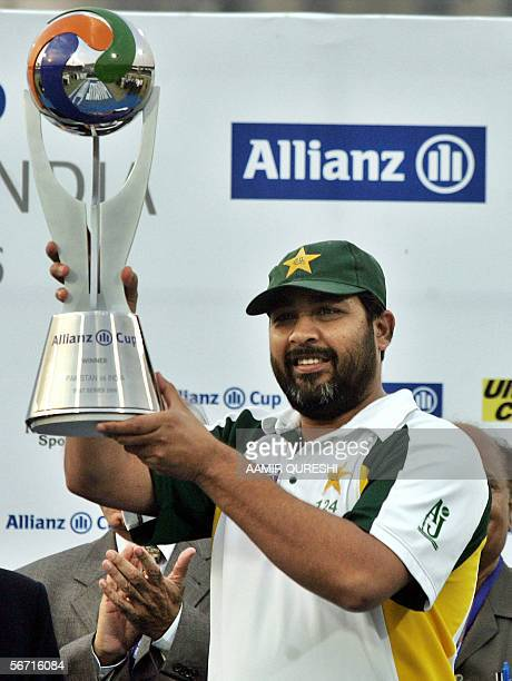 Pakistani cricket team captain InzamamulHaq holds the winning trophy during a presentation ceremony after defeating India on the fourth day of the...