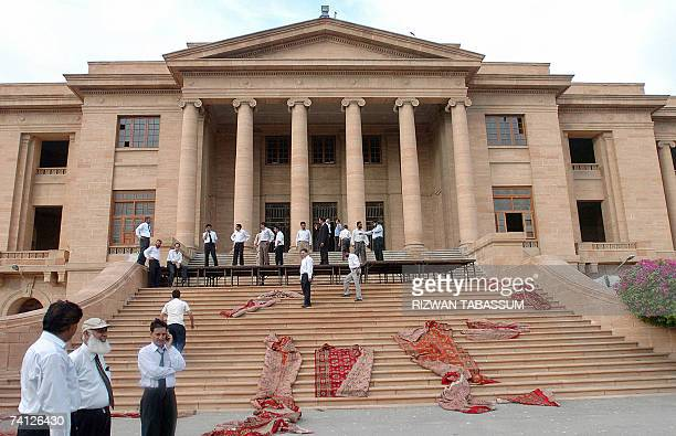 Pakistani lawyers prepare a stage infront of the High Court building in Karachi, 11 May 2007, on the eve of the visit of suspended Chief Justice...