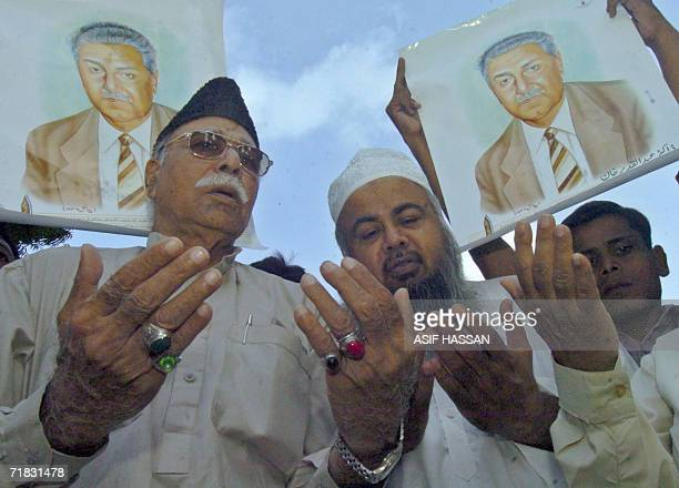 Pakistani men pray for nuclear scientist Abdul Qadeer Khan during a rally in Karachi 09 September 2006 for successful surgery to treat his prostate...