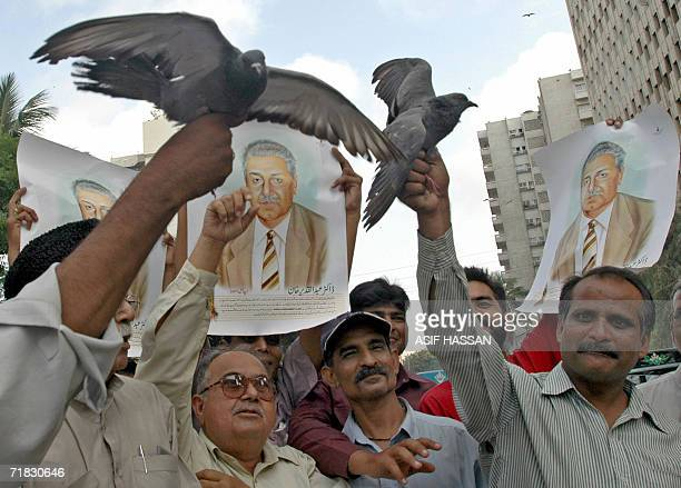 Pakistani men release pigeons for nuclear scientist Abdul Qadeer Khan during a rally in Karachi 09 September 2006 heralding successful surgery to...