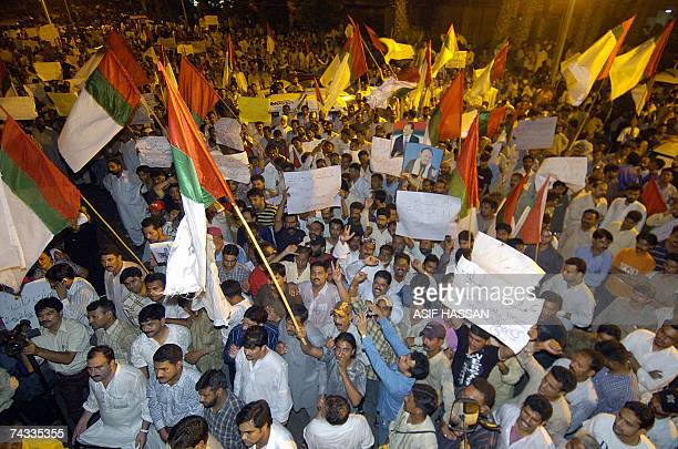 Pakistani proMusharraf party Muttahida Qaumi Movement activists carry party flags and march against former cricketerturned politician Imran Khan...