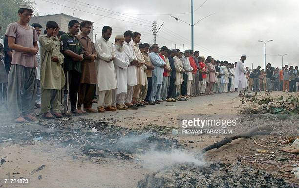 Pakistani protesters offer prayers for tribal rebel chieftain Nawab Akbar Bugti in Karachi 27 August 2006 One man was killed and eleven others...