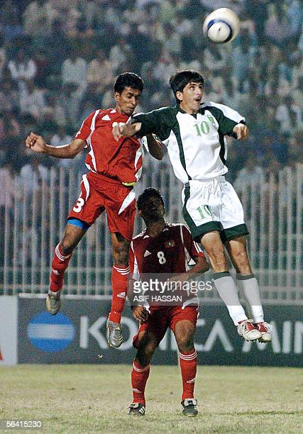 Pakistani soccer player Mohammad Essa vies with Maldives soccer players Shafan Mohamed and Jameel Mohamed during their match of the South Asian...