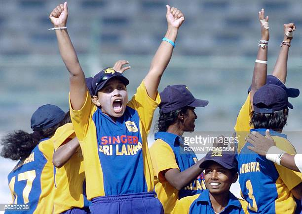 Sri Lankan women cricketers celebrate the dismissal of Indian cricketer Jaya Sharma during the final match between India and Sri Lanka in the Women's...