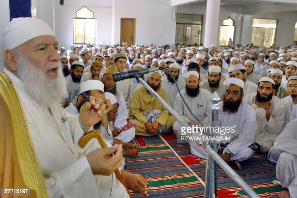 The former Imam of Palestinian Mosque Aqsa Shiekh Ahmed Mahmood Siyam gestures as he addresses students of The Jamia Binoria Islamic University...