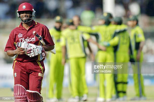 West Indies cricket team captain Brian Lara walks back to the pavillion following his dismissal during the fifth and final OneDay International...