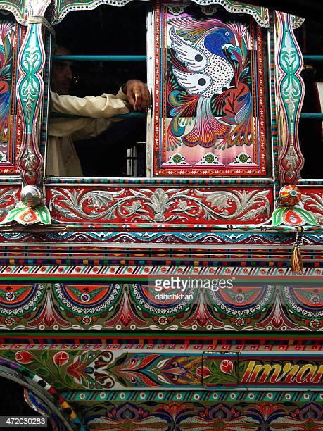 karachi public bus adorned with pakistan's truck art - pakistani culture stock photos and pictures