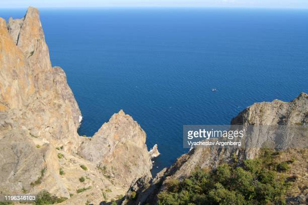 karadag dramatic rock formations by the sea, black sea, crimea - argenberg stock pictures, royalty-free photos & images
