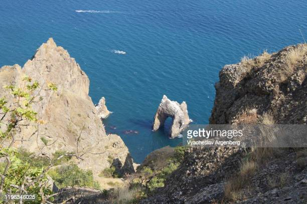 karadag dramatic rock formations by the sea, black sea, jurassic landscape in crimea - argenberg stock pictures, royalty-free photos & images