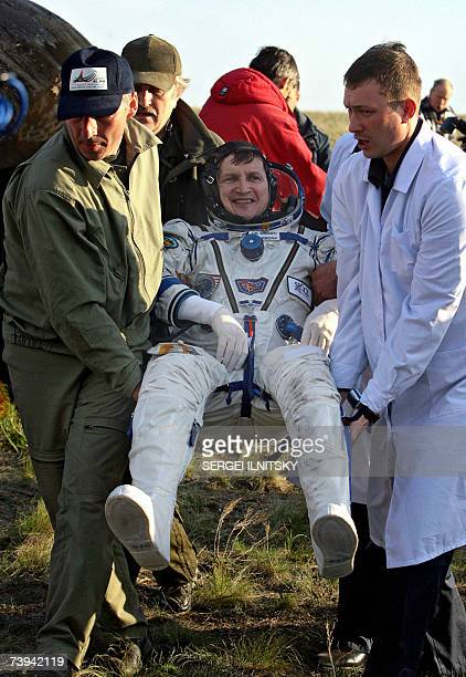 Russian search and recover personnel carry US Space tourist Charles Simonyi shortly after the landing of Russian Souyz TMA9 space capsule in Steppe...