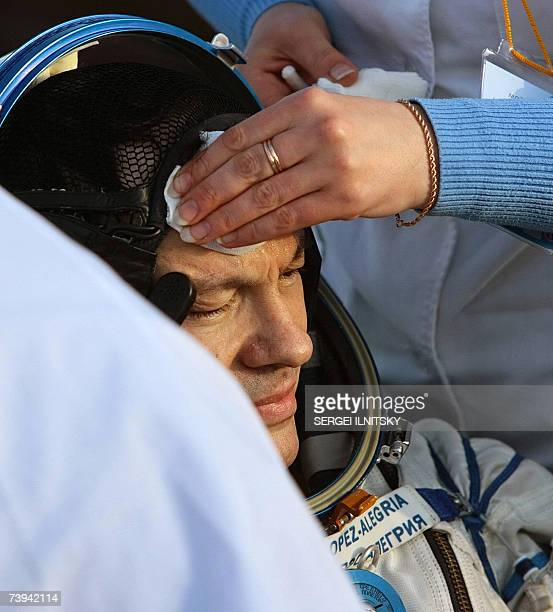 US astronaut Michael LopezAlegria is attended to shortly after the landing of Russian Souyz TMA9 space capsule in Steppe about 500km southwest from...
