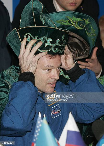 US astronaut Michael LopezAlegria sporting a national Kazakh hat smiles during a press conference in the Kazakh town of Karaganda 21 April 2007 The...
