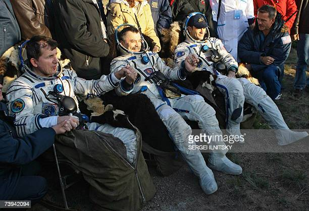 US Space tourist Charles Simonyi poses with US astronaut Michael LopezAlegria and Russian cosmonaut Mikhail Tyurin shortly after the landing of...