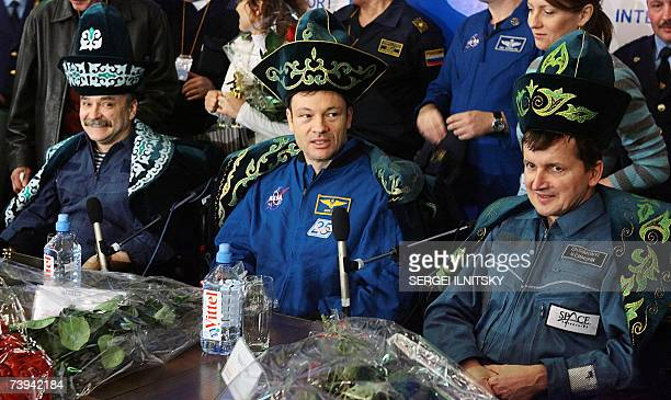 US Space tourist Charles Simonyi US astronaut Michael LopezAlegria and Russian cosmonaut Mikhail Tyurin sporting national Kazakh hats smile during a...