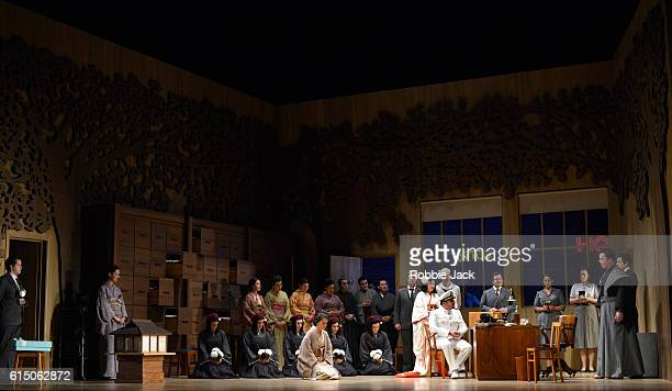 Karah Son as CioCioSan and Matteo Lippi as Lieutenant BF Pinkerton with artists of the company in Giacomo Puccini's Madame Butterfly directed by...