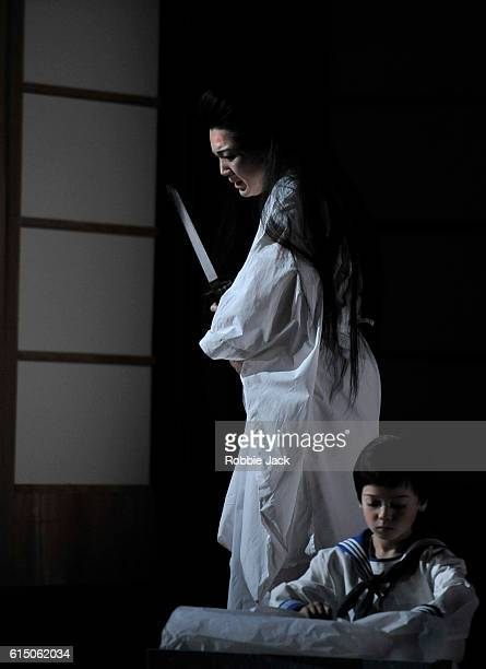 Karah Son as CioCioSan and Rupert Wade as Sorrow in Giacomo Puccini's Madame Butterfly directed by Annilese Miskimmon designed by Nicky Shaw and...