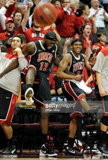 Karam Mashour Brice Massamba and Oscar Bellfield of the UNLV Rebels celebrate on the bench during the team's 9080 win over the North Carolina Tar...