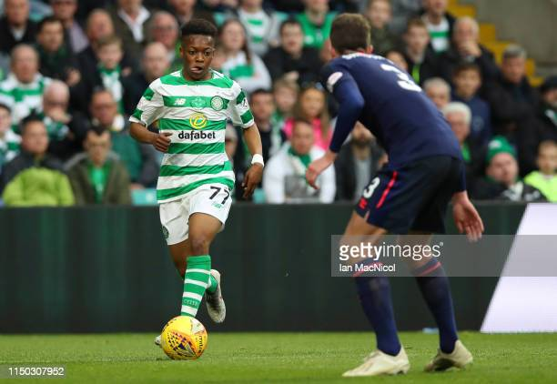 Karamoko Dembele of Celtic is faced by Conor Shaughnessy of Hearts during the Ladbrokes Scottish Premiership match between Celtic and Hearts at...