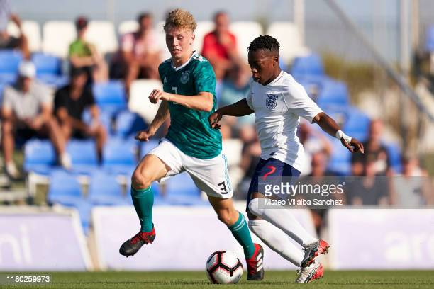 Karamoko Dembele of U17 England competes for the ball with Bent Andresen of U17 Germany during the International Friendly match between U17 England...
