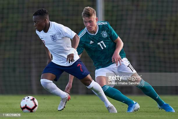 Karamoko Dembele of U17 England competes for the ball with Luca Netz of U17 Germany during the International Friendly match between U17 England and...