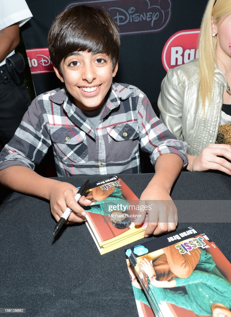 Karan Brar star of the hit series 'Jessie' gets signs autographs for Radio Disney AM 1110 fans at the Wii U Showdown at Westfield Century City Mall in Los Angeles on December 9, 2012. Wii U is one of Nintendo's hottest items of the holiday season.