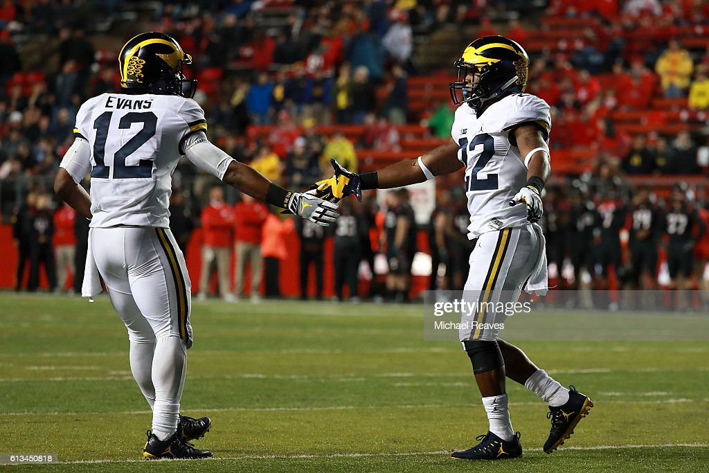 Karan Higdon #22 of the Michigan Wolverines celebrates with Chris Evans #12 after scoring a touchdown in the second half against the Rutgers Scarlet Knights at High Point Solutions Stadium on October 8, 2016 in Piscataway, New Jersey.