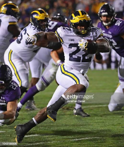 Karan Higdon of the Michigan Wolverines runs for the game winning touchdown against the Northwestern Wildcats at Ryan Field on September 29 2018 in...