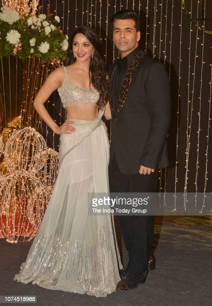 Karan Johar and Kiara Advani pose for cameras at Priyanka Chopra and Nick Jonass reception in Mumbai