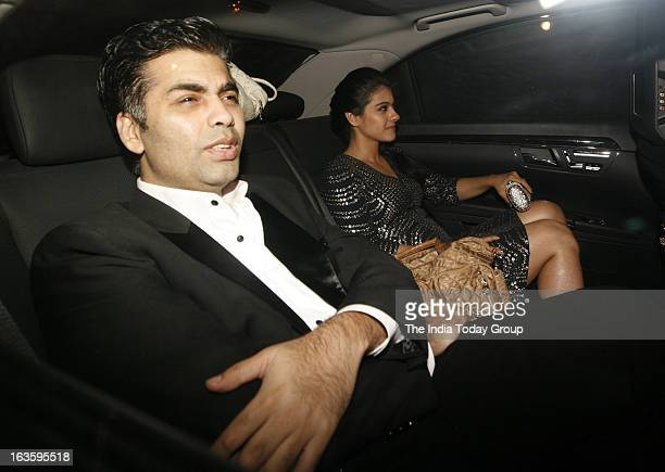 Karan Johar arrives with Kajol at a bash hosted in honour of H'wood director Steven Spielberg in Mumbai on March 12 2013
