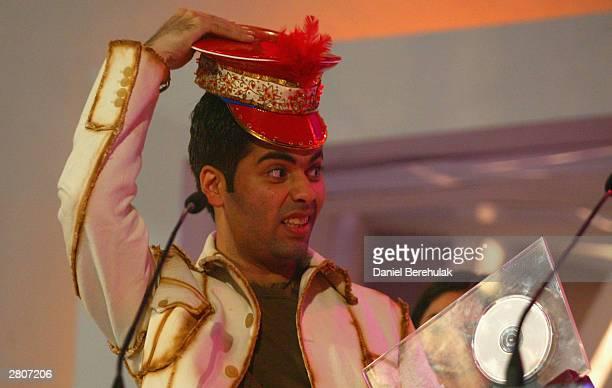 Karan Johar receives his award for Best Album during the Inaugural MTV IMMIES at the Goregaon Sports Club December 12 2003 in Mumbai India