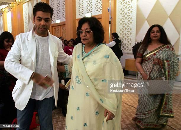 Karan Johar with his mother and Kiron Kher Kiran Kher coming for the music launch of Bollywood movie Kabhi Alvida Naa Kehna at grand hayatt Dubai on...