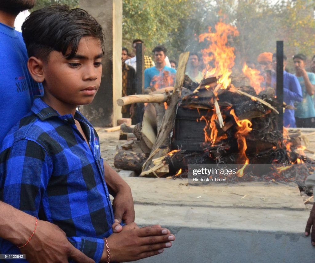 Karan son of Sonu who killed in Iraq during his cremation at his native village Chawinda Devi on April 2 2018 near Amritsar India