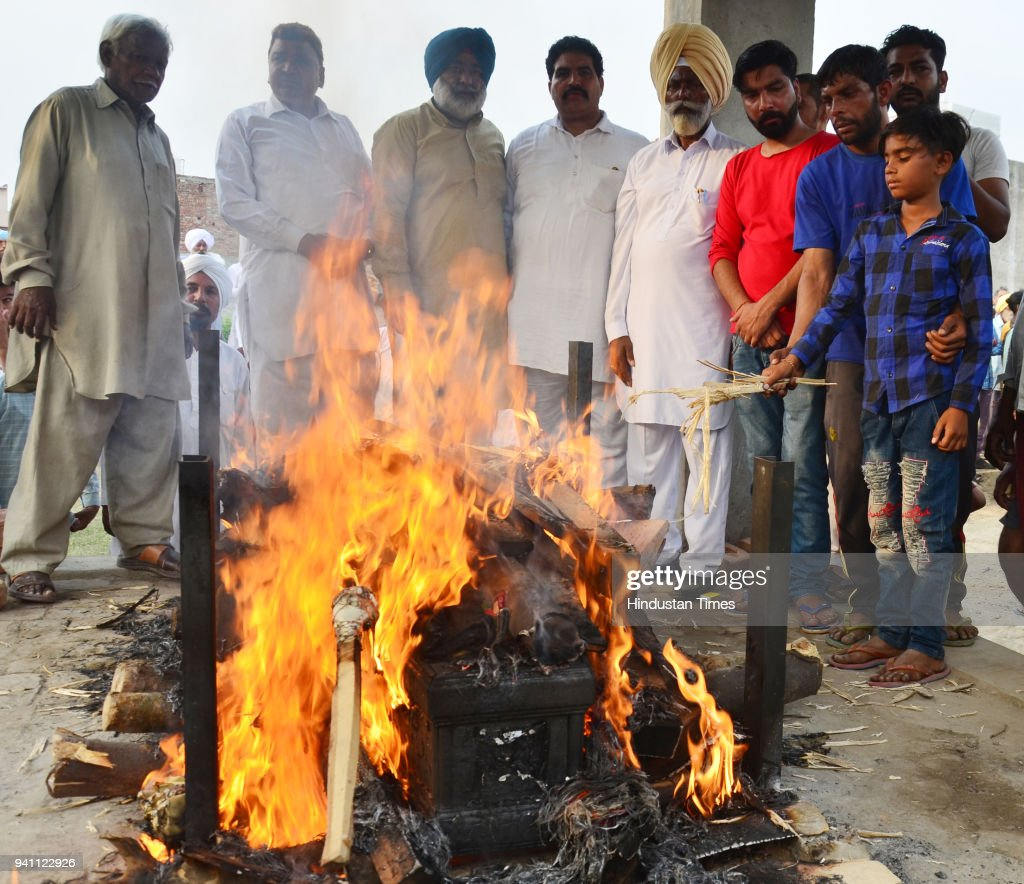 Karan son of Sonu who killed in Iraq during his fatherss cremation at his native village Chawinda Devi on April 2 2018 near Amritsar India A special..