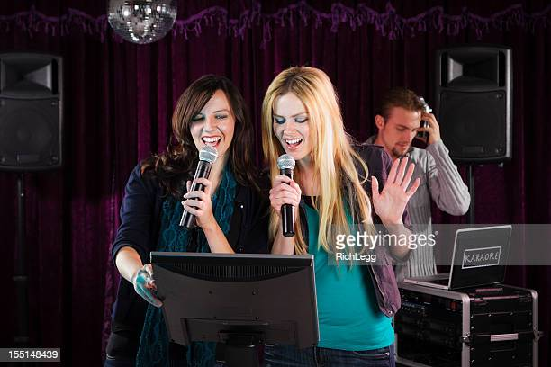 karaoke singers - blonde female singers stock photos and pictures