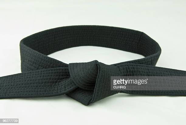 karate belt  black - martial arts stock photos and pictures