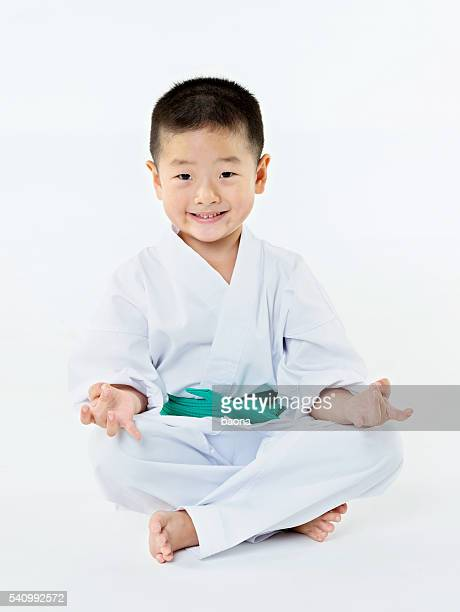 Karate boy sitting on floor