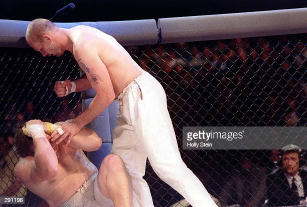 Karate champion Gerard Gordeau of Ansterdam prepares to strike kickboxer Kevin Rosier of after knocking him down during the Ultimate Fighter...