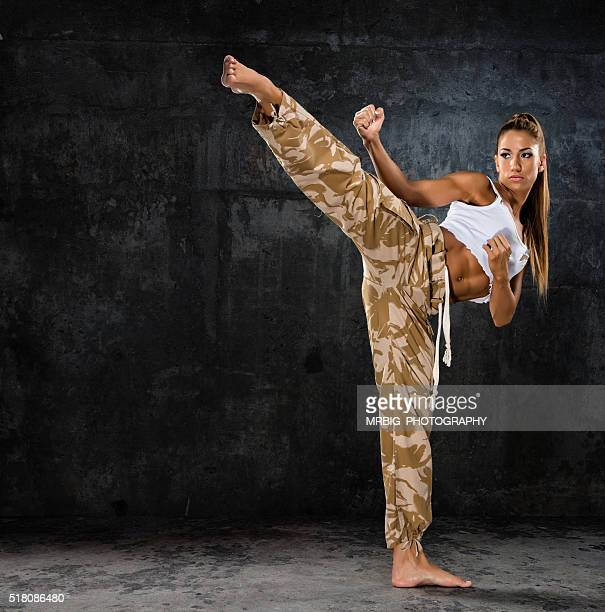 karate girl - girl fight stock photos and pictures