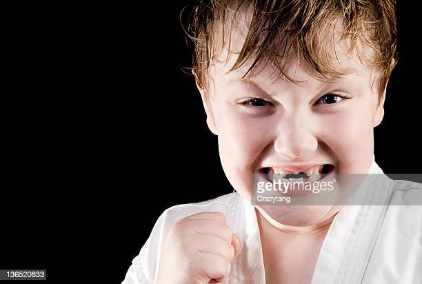 karate kid with no teeth - boxing belt stock pictures, royalty-free photos & images