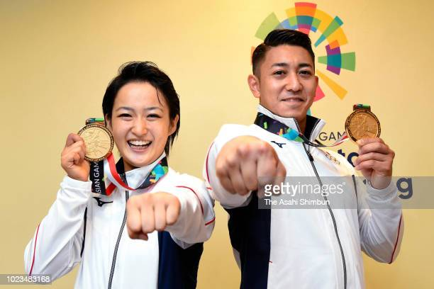 Karate women's Kata gold medalist Kiyou Shimizu and men's Kata gold medalist Ryo Kiyuna of Japan pose for photographs at the Jakarta Convention...
