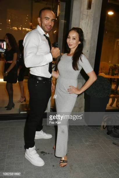 Karateka champion Djema Belkhodja and actress/blogger Celine Tran attends the 'Champion Spirit' Rive Gauche Launch Party at Beaupassage 14 Bd Raspail...