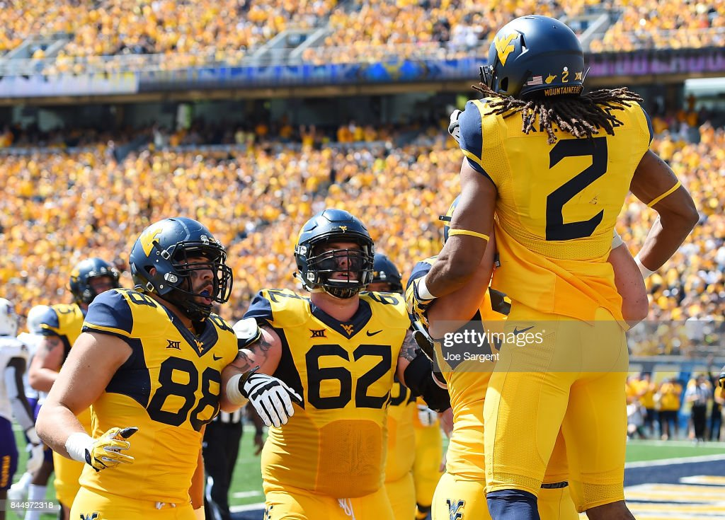 Ka'Raun White #2 of the West Virginia Mountaineers celebrates his touchdown with teammates during the first quarter against the East Carolina Pirates at Mountaineer Field on September 9, 2017 in Morgantown, West Virginia.