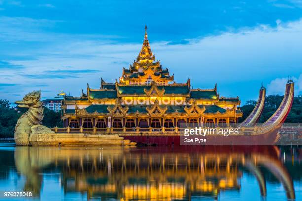 karaweik palace at evening, yangon, myanmar - myanmar culture stock pictures, royalty-free photos & images