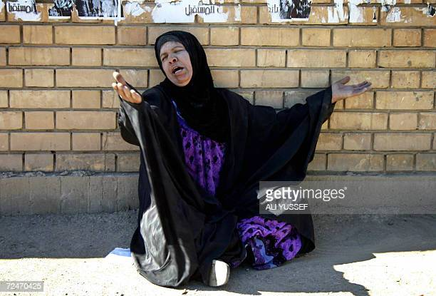 An Iraqi woman weeps beside the bodies of men killed in raging sectarian violence in the restive city of Baquba 60 kms northeast of Baghdad 09...