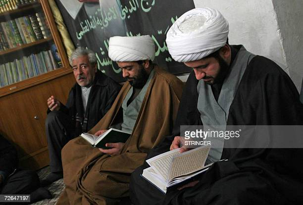 Shiite Iraqi clerics read verses from the holy Koran during a wake for Sadr City's victims in the holy city of Karbala in central Iraq 26 November...