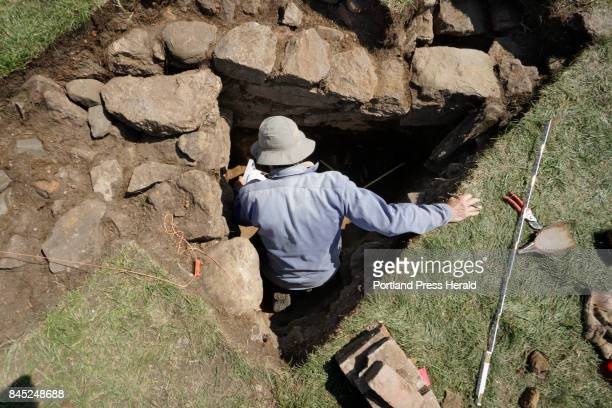 Kare Mathiasson a retired archaeologist with the Maine Historic Preservation Commission writes down details of a stone wall discovered during an...