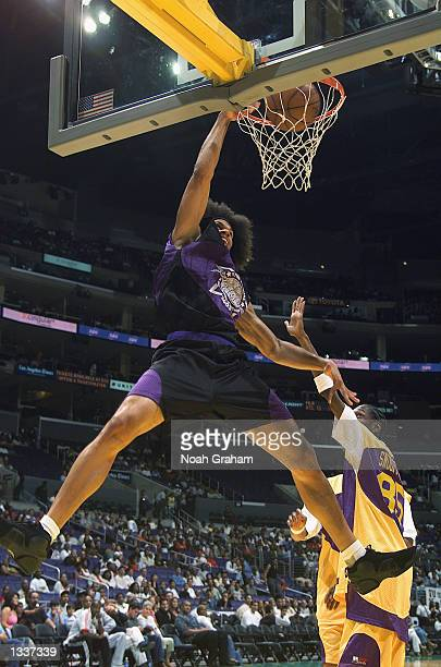 Kareem Abdul Jabbar Jr throws down the thonder during the first half of action in the Celebrity portion of A Midsummer Night's Magic at Staples...
