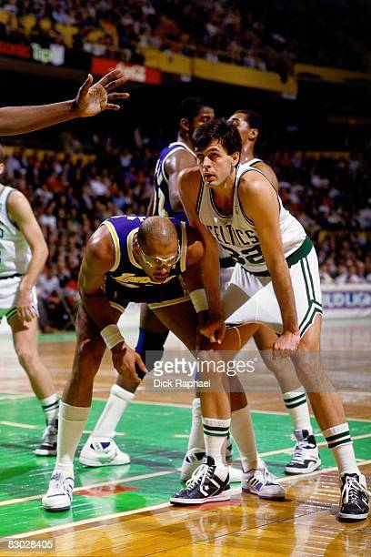 Kareem Abdul Jabbar of the Los Angeles Lakers defends against Kevin McHale of the Boston Celtics during a game circa 1988 at the Boston Garden in...